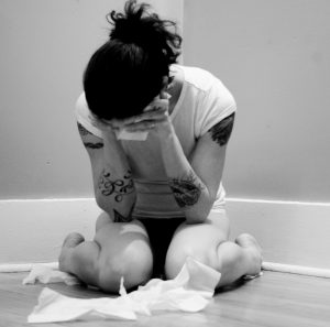 depressed sad girl crying in the corner
