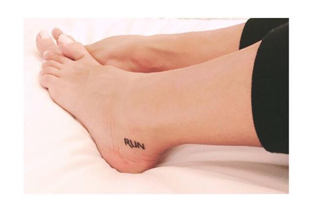feet with run tattoo