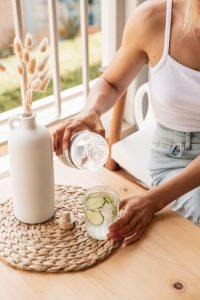 woman drinking cucumber water